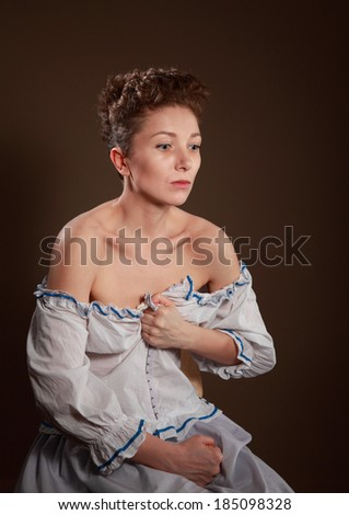 Girl in the image of a poor peasant with the suffering on her face and wild-eyed, actress - stock photo