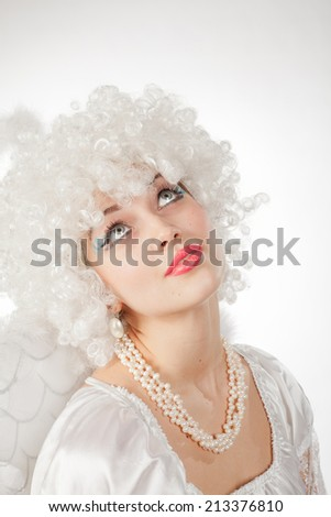 girl in the image of an angel with a funny haircut