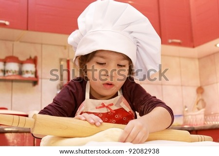 Girl in the kitchen with rolling pin