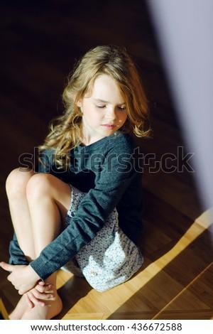 girl in the light beam - stock photo