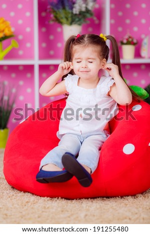 girl in the nursery. emotions, fun, smile, children's world - stock photo