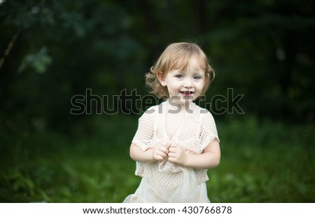 girl in the park, selective focus - stock photo