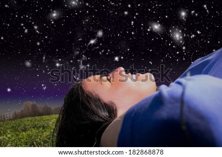 girl in the park watching night sky - stock photo