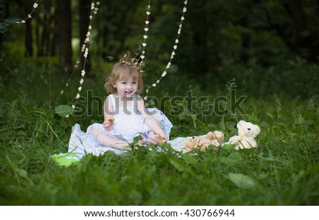 girl in the park, wearing crown, selective focus - stock photo