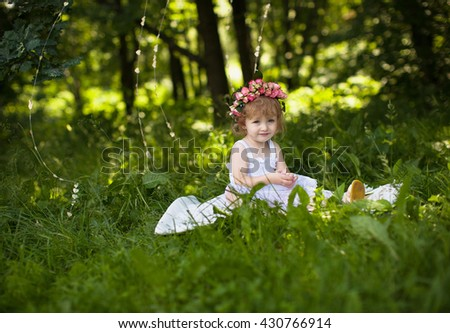 girl in the park, wearing floral headband, selective focus - stock photo
