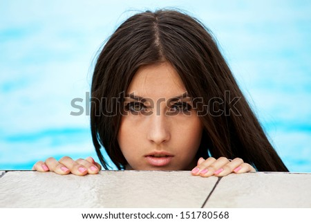 Girl in the swimming pool, close up shooting - stock photo