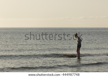 girl in the water with his dog in Santa Pola, Alicante, Spain