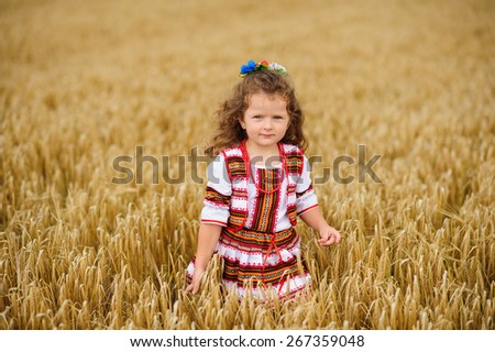 girl in the yellow  wheat field - stock photo