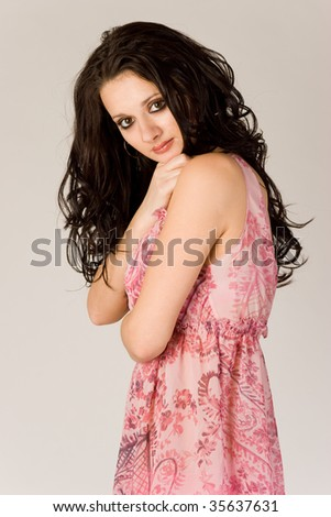 Girl in transparent clothing over white background, studio shot - stock photo