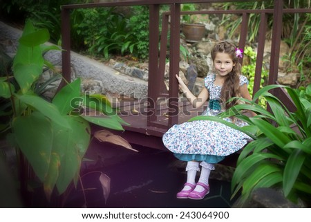 Girl in tropical garden - stock photo