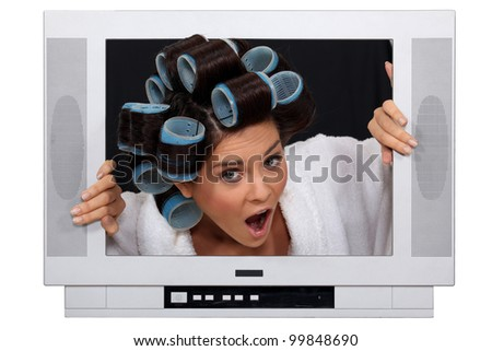 girl in TV screen with hair curlers - stock photo