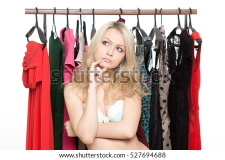 girl in underwear from clothes hangers. choice of dress