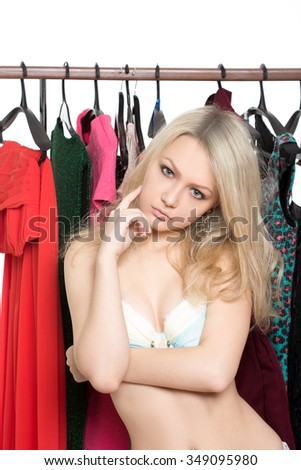 girl in underwear from clothes hangers. Isolated white background. choice of dress. person makes a choice