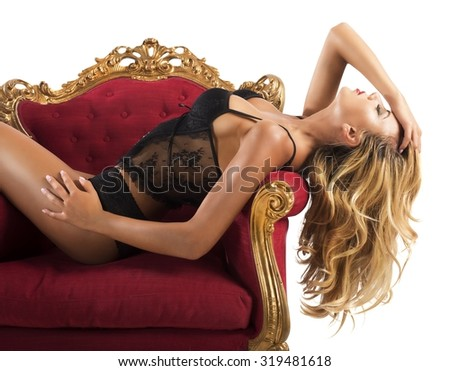 Girl in underwear posing in an armchair - stock photo
