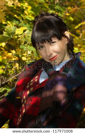Girl in vintage clothes in autumn colors
