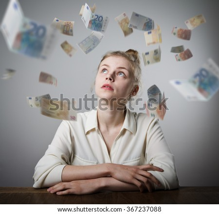 Girl in white and falling Euro banknotes. Currency and lottery concept. Young slim woman. - stock photo