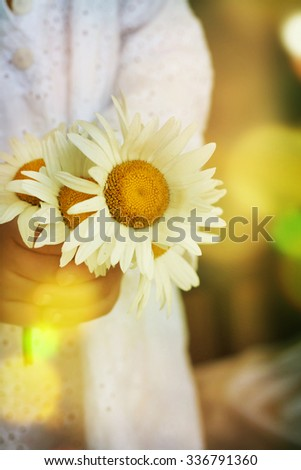 girl in white dress going to the first holy communion - stock photo