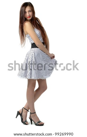 Girl in white dress in black polka dots, isolated on white