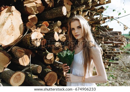 Girl in white dress in the forest in summer