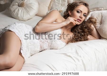 girl in white dress in the interior - stock photo