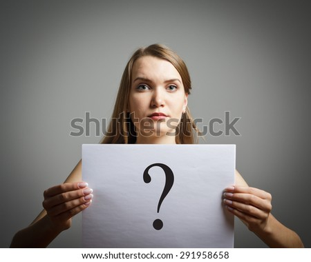 Girl in white having no answers to a question. - stock photo