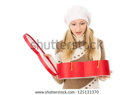girl in winter cap holding a gift - stock photo