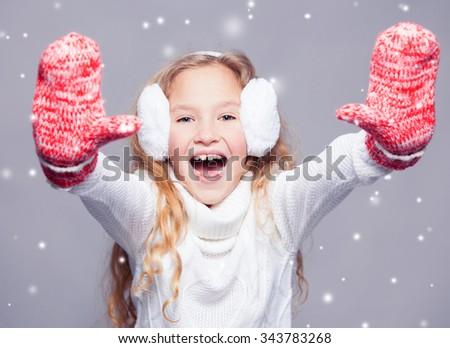 Girl in winter clothes. Happy child. Studio shot - stock photo
