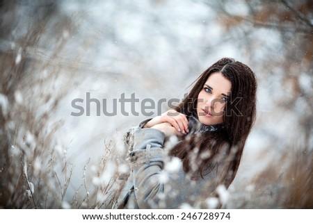 Girl in winter forest frozen - stock photo