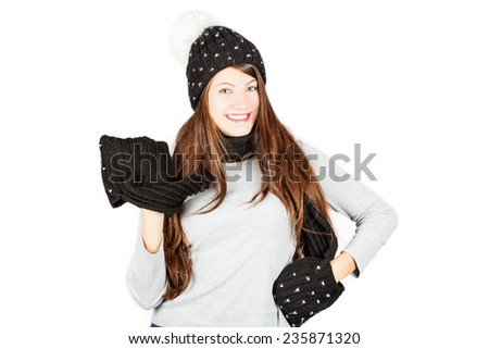 Girl in winter hat and scarf. Portrait isolated on white background