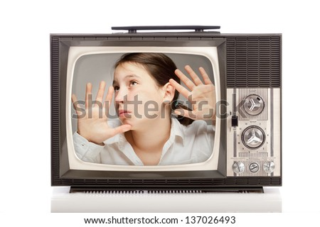 girl inside a retro portable television on white background