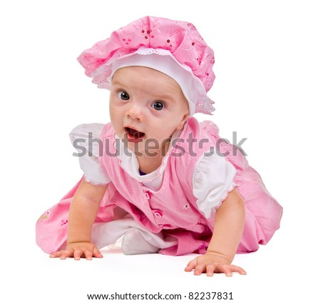 girl is a baby.step.little girl in a pink dress on a white background