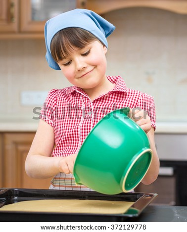 Girl is cooking in kitchen, indoor shoot - stock photo