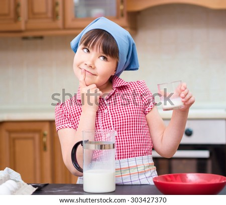 Girl is cooking, thinking while looking up, indoor shoot - stock photo