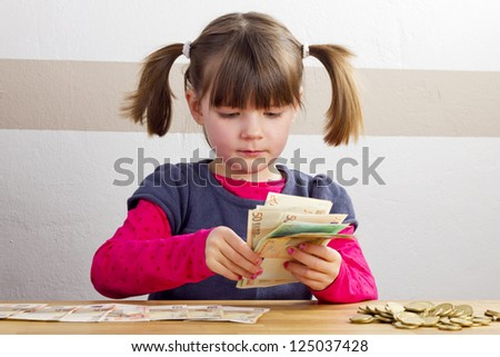 Girl is counting bank notes - stock photo