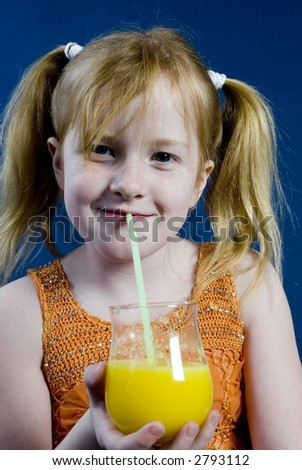 Girl is drinking lemonade - stock photo