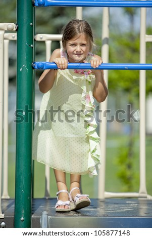 girl is having fun in the playground - stock photo