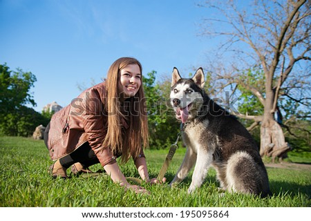 Girl is having fun with her cute huske dog
