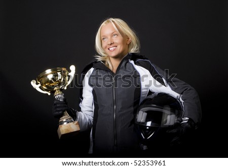 Girl is holding her gold cup and smiling