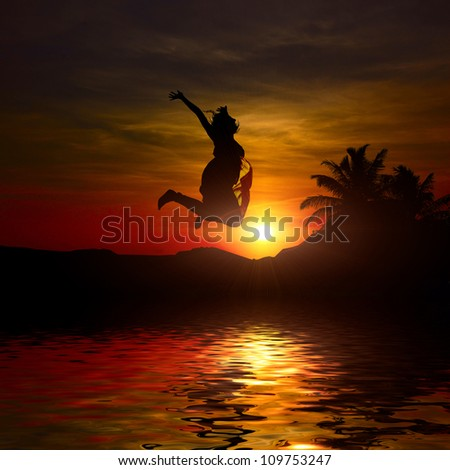 girl is jumping at the sunset