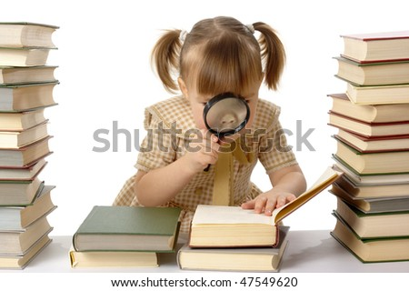 Girl is looking at books through magnifier, isolated over white - stock photo