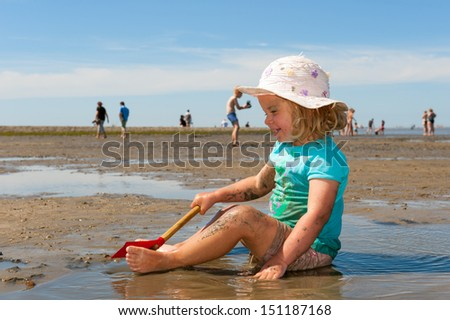 girl is playing on the low tide- beach - stock photo