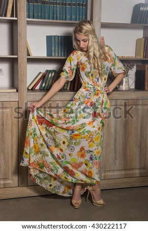 Girl is playing with a long colored dress