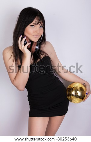 Girl is posing and holding a sphere - stock photo