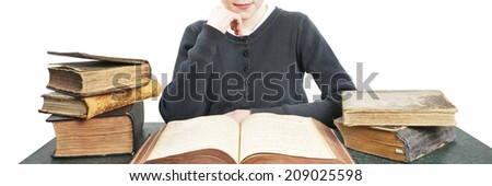 girl is reading a lot of books - stock photo