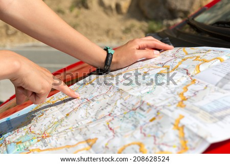 Girl is reading a map - stock photo