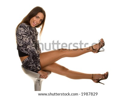 Girl is sitting at chair holding up legs