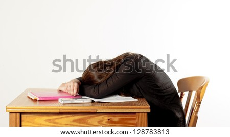 girl is sleeping while studying, with her head on the table
