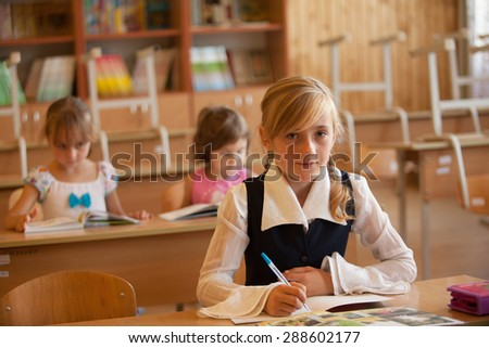 Girl is studying in classrom at the desk