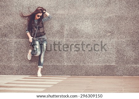 girl is walking in the downtown - stock photo