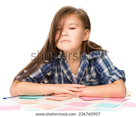 Girl is writing on color stickers, tired, isolated over white